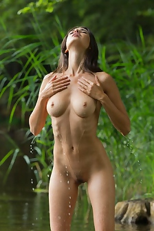 Jasmin Nude Wading In The Water
