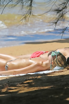 Margot Robbie Topless Sunbathing On The Beach