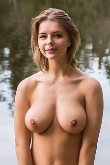 Busty Hottie Posing At The Lake